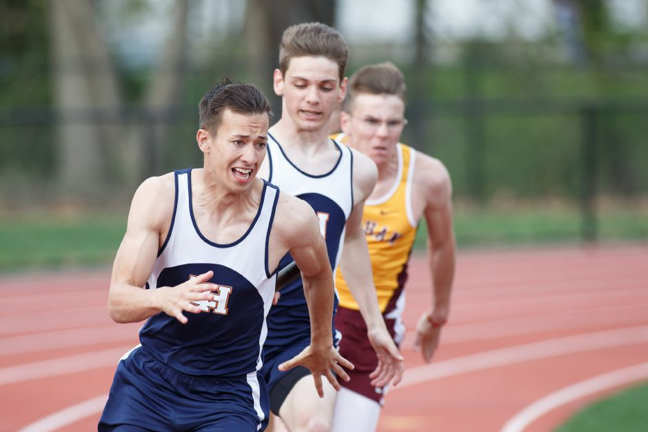 Blake Jandreau set a new Lyman Hall record in winning the 400 meters in 49.43 seconds at the SCC track and field championship meet Wednesday at Amity. | Justin Weekes / Special to the Record-Journal