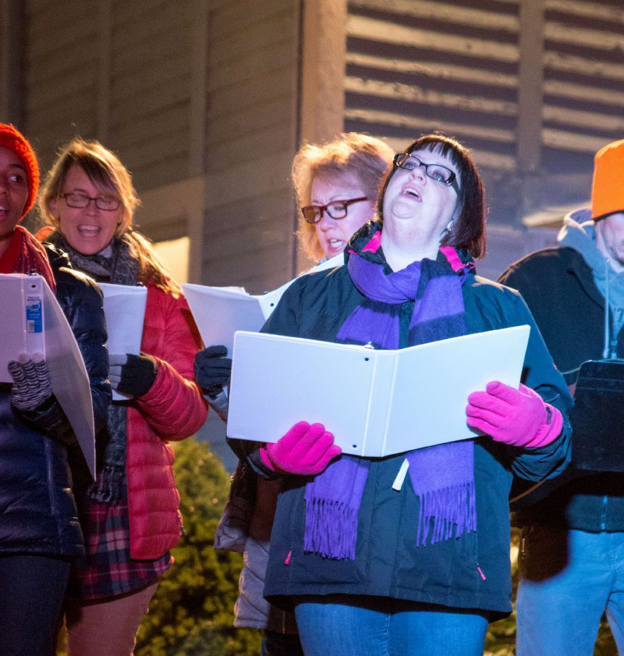 Parishioners sing at Plantsville