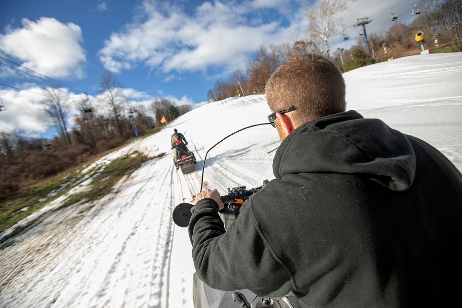 Shane Riley, snow-making supervisor, heads up the mountain on a snowmobile at Mount Southington, Thurs., Nov. 29, 2018. Dave Zajac, Record-Journal