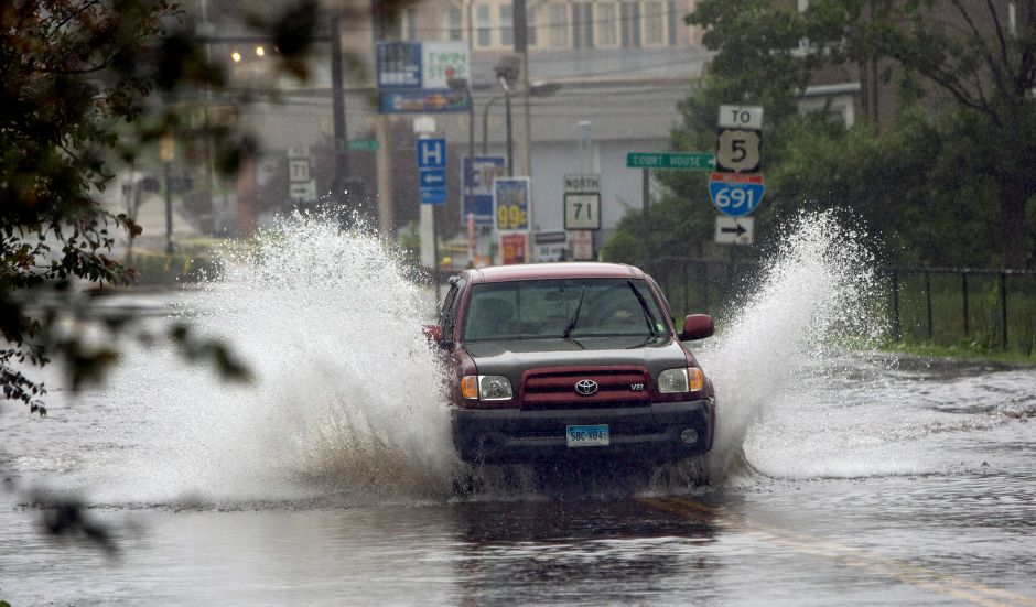 A motorist plows through flooded Cook Avenue during storm Irene Sunday morning August 28, 2011. (Dave Zajac/Record-Journal)