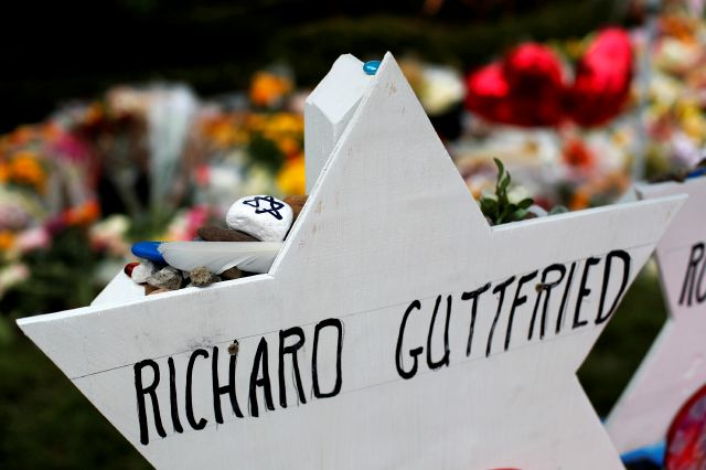 This photo shows a memorial to Richard Guttried, on Wednesday, Oct. 31, 2018, part of a makeshift memorial outside the Tree of Life Synagogue to the 11 people killed during worship services Saturday in Pittsburgh. (AP Photo/Gene J. Puskar)