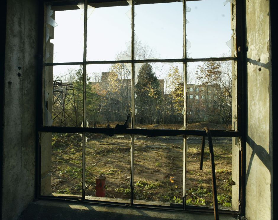 View of the Medical Arts Building at 116 Cook Ave. as seen through the broken window of the power plant for the former International Silver Co.