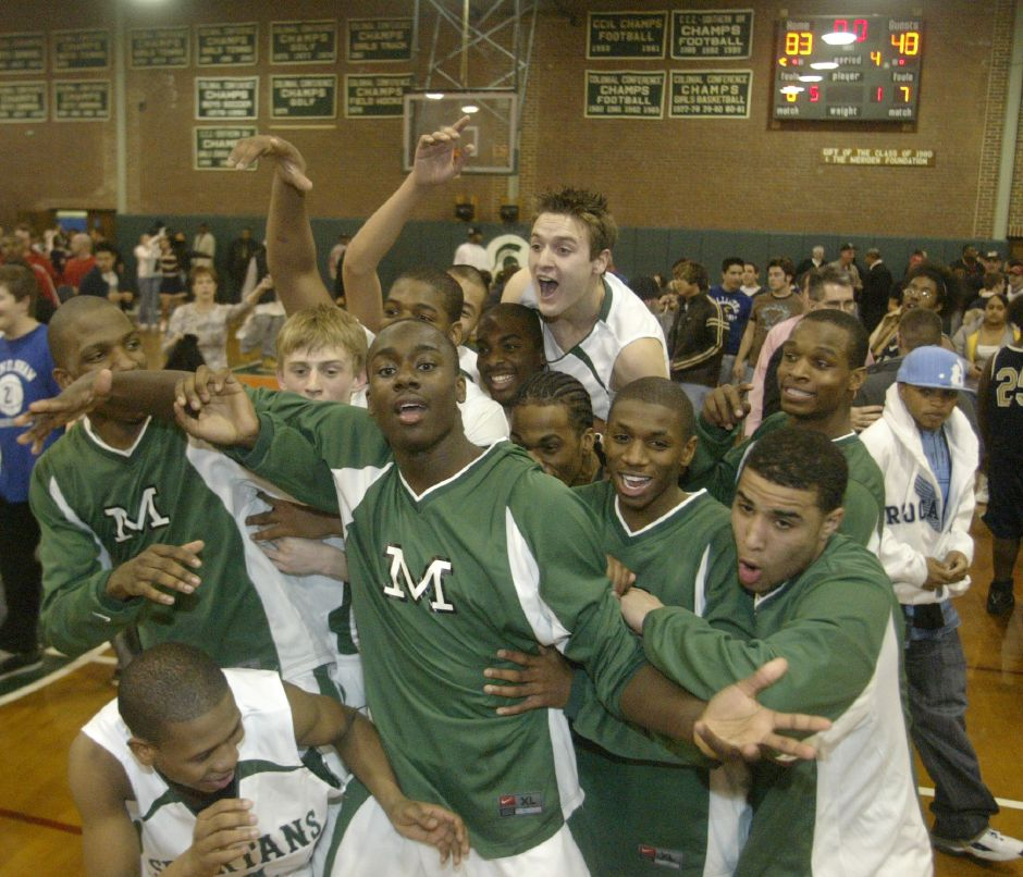 The Maloney basketball teams celebrates going undefeated for the season after their victory over Platt on Feb. 21, 2007.