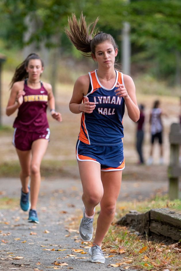 Lyman Hall's Olivia Weir heads to the finish with Sheehan's Ariana Amodio looking to close the gap. Amodio wound up finishing second and Weir third.