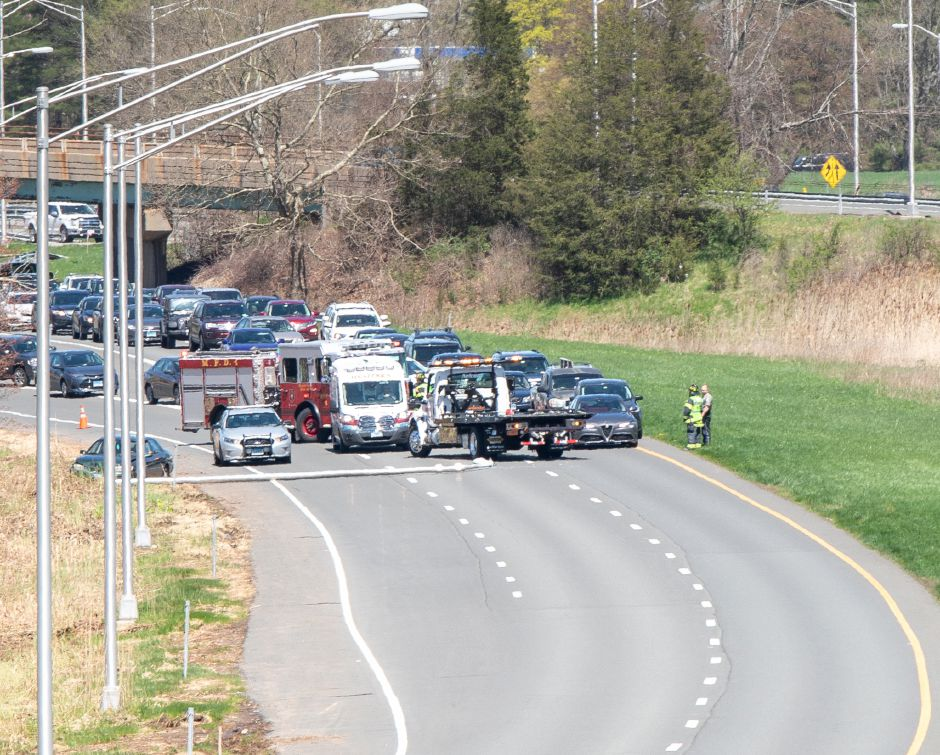 Traffic was reduced to one lane on Route 15 south after a vehicle crashed into a light post near the East Main Street on ramp Wednesday afternoon. No injuries were reported. April 24, 2019. | Devin Leith-Yessian/Record-Journal