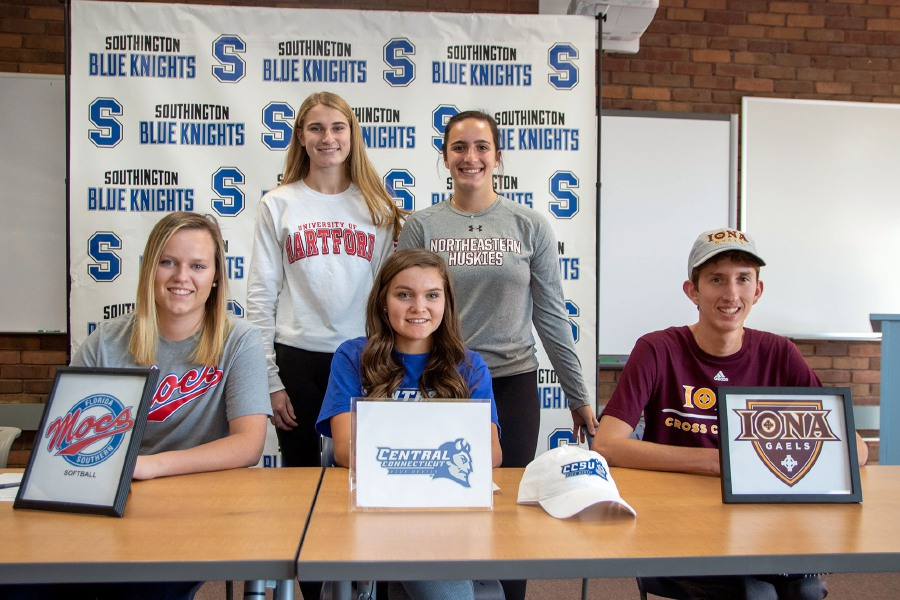 Five seniors from Southington High School signed National Letters of Intent on College Signing Day Wednesday. Southington held its ceremony in the school library. Seated, left to right, are Katie Gundersen (softball, Florida Southern), Katherine Crouse (soccer, Central Connecticut) and Matt Penna (cross country/track, Iona). Standing, left to right, are track and field teammates Sydney Garrison (Hartford) and Trinity Cardillo (Northeastern).  Aaron Flaum, Record-Journal