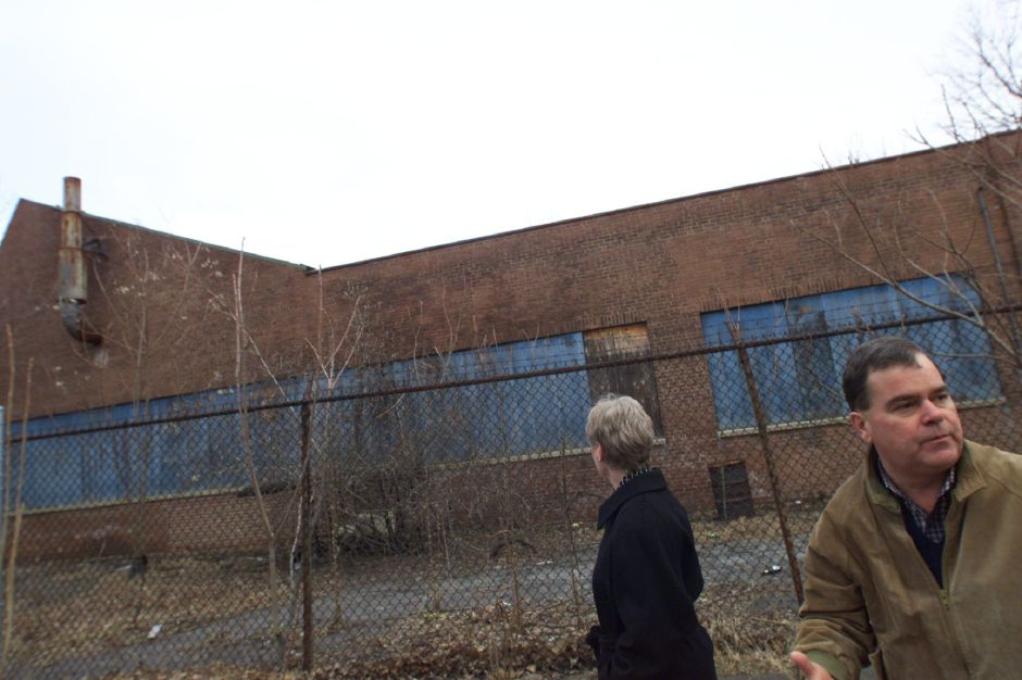 Meriden Economic Development Director Randall Kamerbeek and Economic Development Asssitant Trudy Magnolia give a tour of the defunct and fire-damaged Factory H.