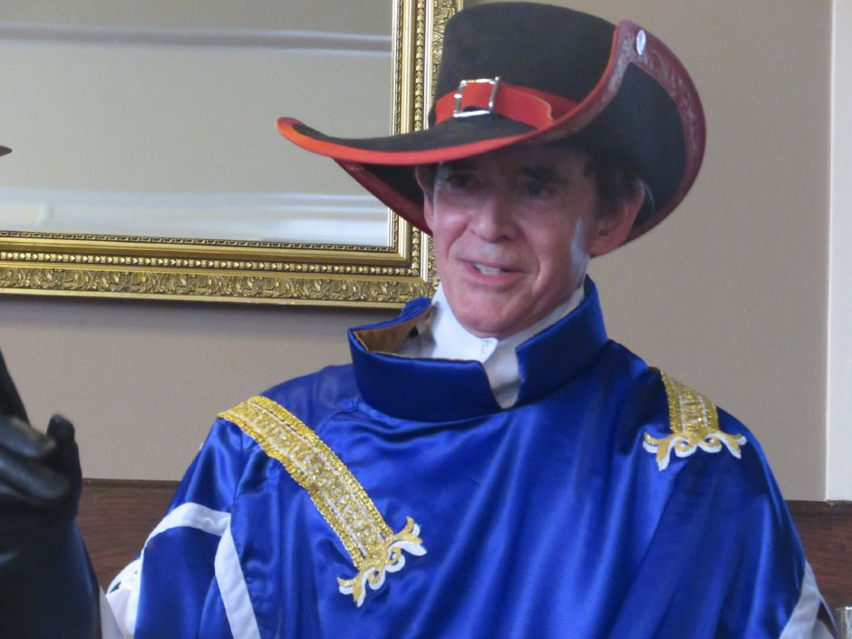 Dressed as one of the Three Musketeers, Wallingford Mayor William W. Dickinson Jr. announced his intention to run for re-election this fall during the Republican Town Committee meeting Wednesday, July 10, 2019. | Lauren Takores, Record-Journal