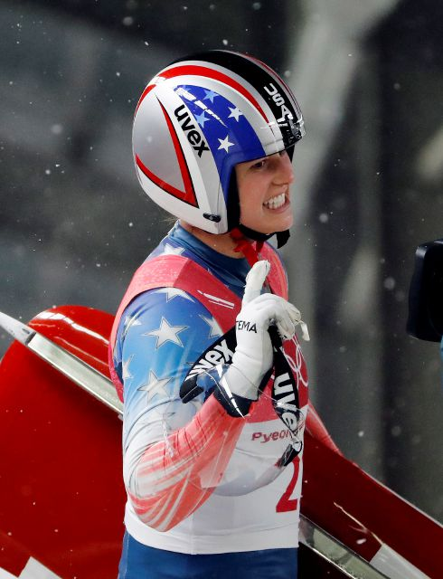 Emily Sweeney of the United States waves after her third run during the women
