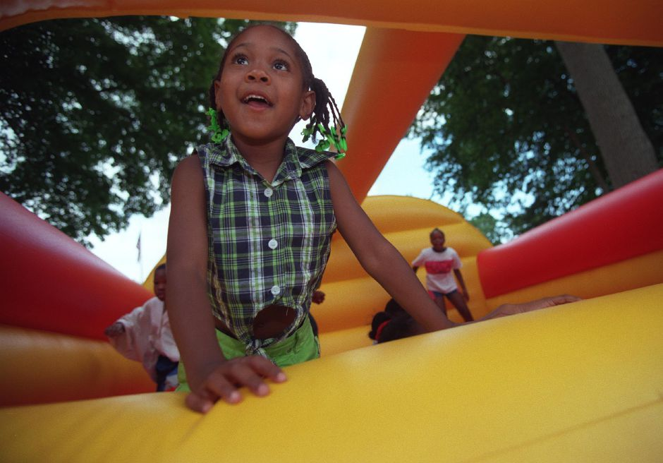 RJ file photo - Asia Johnson, 4, of Meriden, bounces around with other kids in a large air filled bubble ride at the Black Expo in Hubbard Park in Meriden Saturday June 19, 1999.
