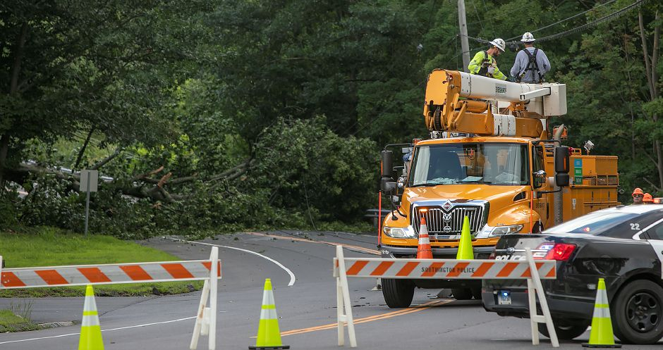 Utility crews work to restore power on Meriden Avenue in Southington, Monday, July 23, 2018. More than 1,000 local Eversource Energy customers were without power after police said a tree fell and damaged utility poles and power lines near 905 Meriden Ave. Dave Zajac, Record-Journal