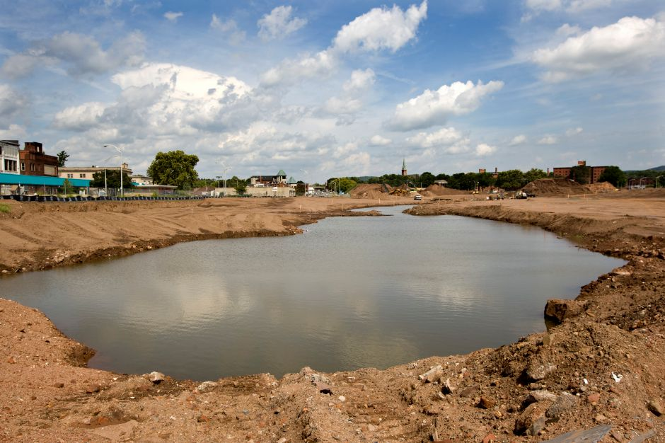 Surface water runoff fills a retention area running through the Hub site in Meriden, Tuesday, September, 2, 2014. | Dave Zajac / Record-Journal