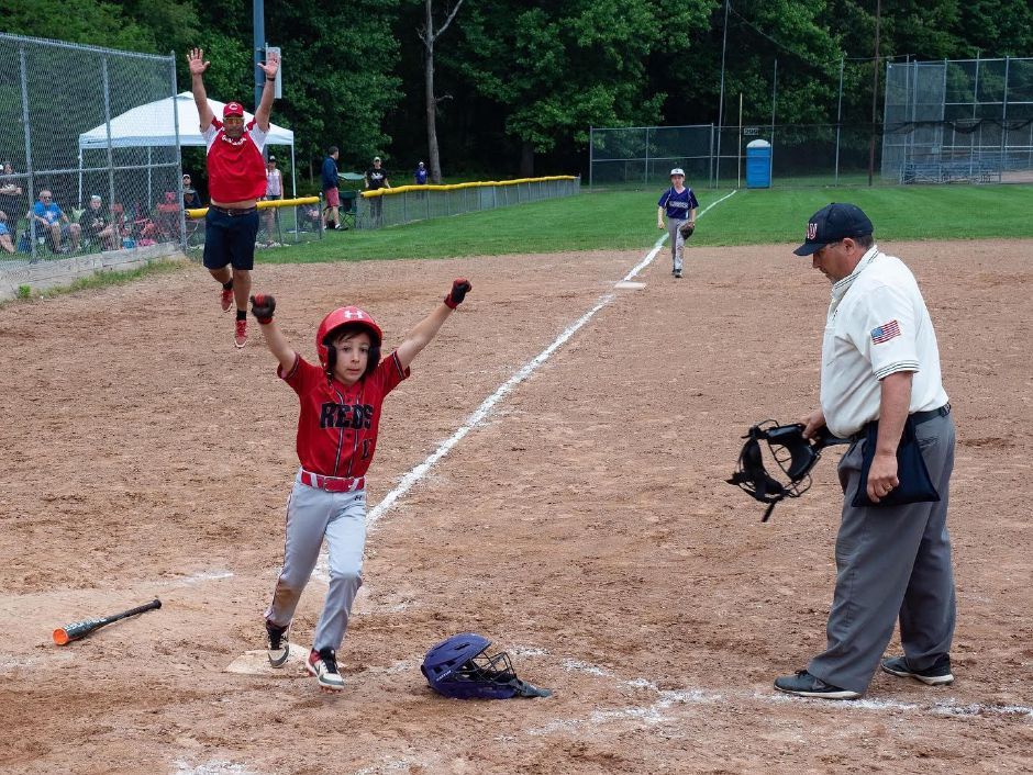 Ben Gesseck scores the winning for the Cheshire 9U Reds in their 5-4 championship victory over the Shoreline Sluggers in the East Shore Travel final at Lupone Field in Clinton. The Reds finished the season 22-0. / Photo by Richard Correale