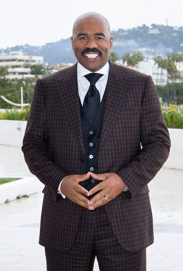 U.S. comedian and talk show host Steve Harvey poses for photographers during the world