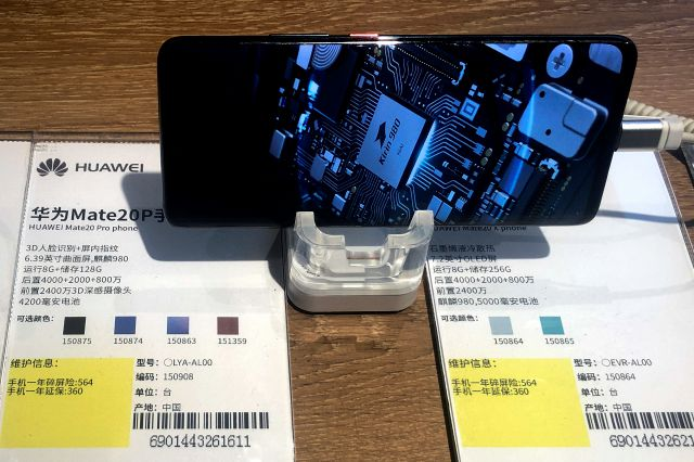 A Huawei Mate20P smartphone model showing its own Kirin chip processor is displayed at an electronic store in Beijing, Monday, May 20, 2019. Google assured users of Huawei smartphones on Monday the American company