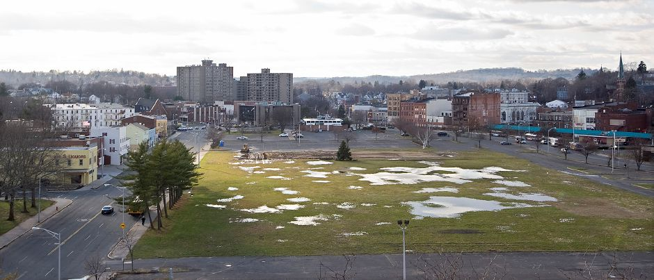 Pools of water collect on the grassy area of the Meriden Hub in downtown Meriden Thursday December 8, 2011. Ground is expected to be broken on the uncovering of Harbor Brook project before the end of 2012. Harbor Brook runs underneath the Hub site. (Dave Zajac/Record-Journal)