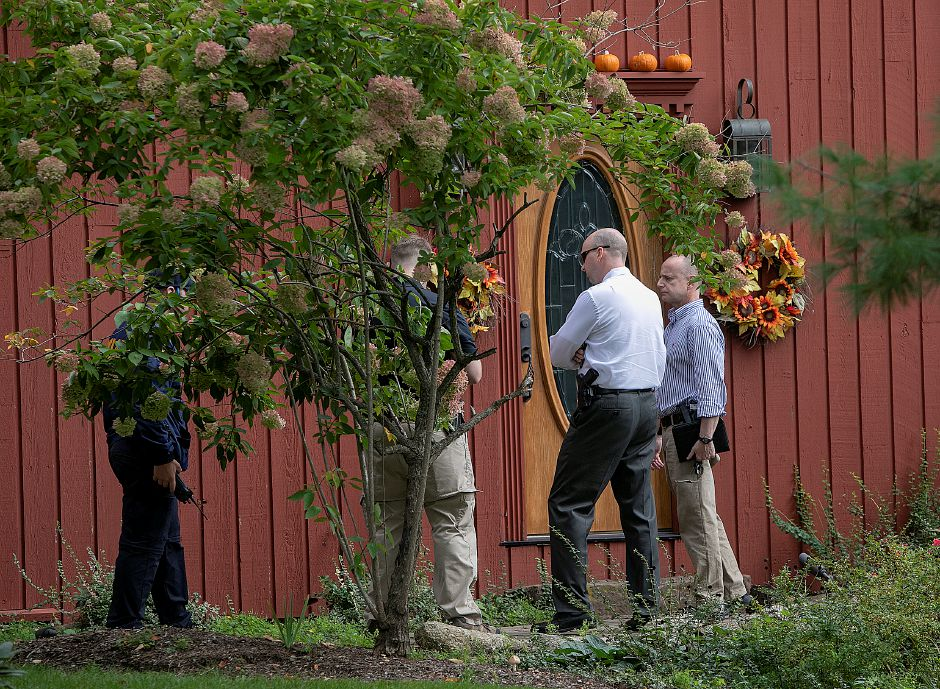 Investigators visit a home at 1272 Notch Rd. after a missing person was found dead near the intersection of Mixville and Marion roads in Cheshire, Wednesday, Oct. 4, 2018. | Dave Zajac, Record-Journal