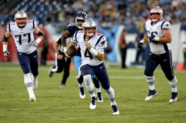 New England Patriots quarterback Jarrett Stidham (4) scrambles against the Tennessee Titans in the second half of a preseason NFL football game Saturday, Aug. 17, 2019, in Nashville, Tenn. (AP Photo/Mark Zaleski)