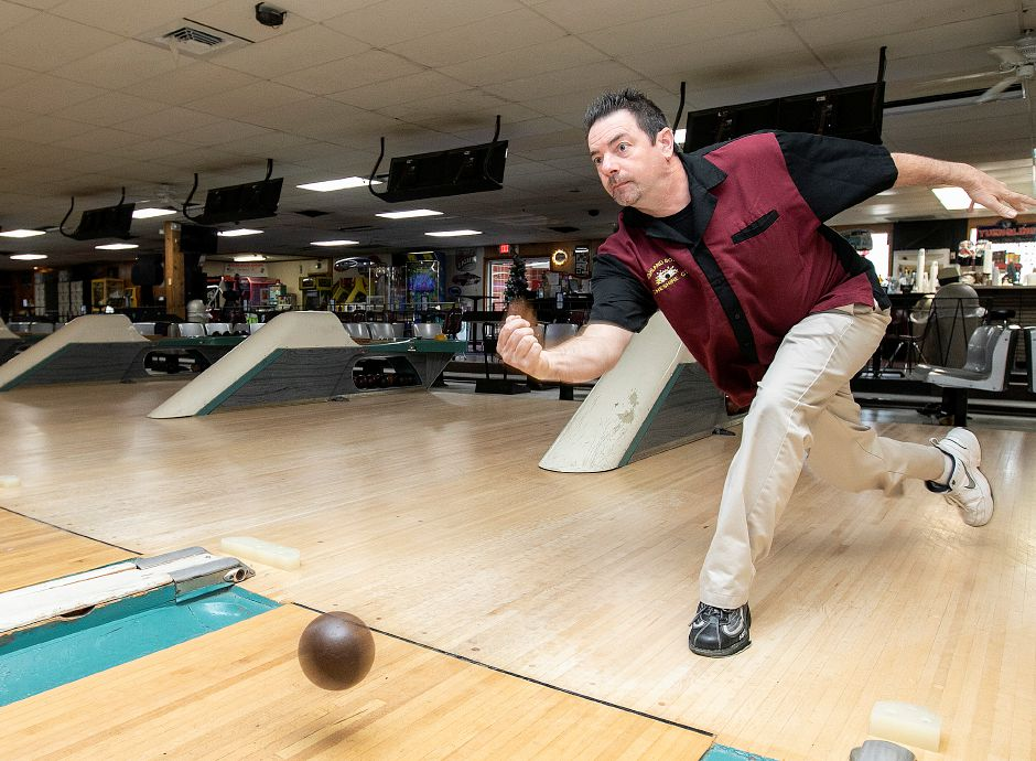 Todd Turcotte, owner of Highland Bowl, rolls a  practice ball at the 1211 Highland Ave. business in Cheshire last Friday. Highland Bowl is a 20-lane family-owned duckpin bowling center. Photos by Dave Zajac, Record-Journal