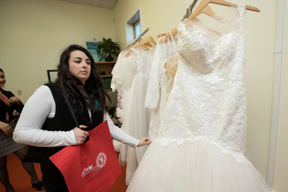 Michelle DaConto of Wallingford look through the gowns Saturday during the second annual Bridal Expo at the Hubcap in Wallingford February 16, 2019 | Justin Weekes / Special to the Record-Journal