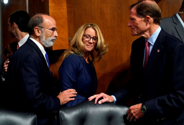 Christine Blasey Ford, center, arrives to testify before the Senate Judiciary Committee on Capitol Hill in Washington, Thursday, Sept. 27, 2018. (AP Photo/Andrew Harnik, Pool)