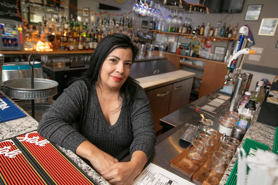 Rosa Valle, owner of the new Mojitos Sports Bar and Grill at 190 Camp St. in Meriden on Friday. Valle also operates Caribbean Restaurant at nearby 311 Center St. Mojitos is located in the building that once housed Rosie's Cafe. Dave Zajac, Record-Journal