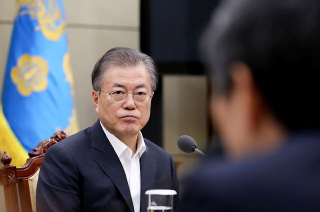 In this photo provided by South Korea Presidential Blue House, South Korean President Moon Jae-in listens a report from officials about the General Security of Military Information Agreement, or GSOMIA, at the Presidential Blue House in Seoul, South Korea, Thursday, Aug. 22, 2019. South Korea will stop exchanging classified intelligence on North Korea with Japan amid a bitter trade dispute, an official said Thursday, a surprise announcement that is likely to set back U.S. efforts to...