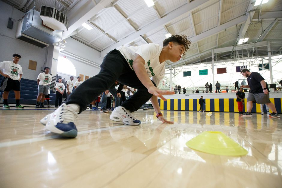 Tijion Johnson 12 of Meriden runs a drill Saturday during the United Way NFL weekend kids camp at Choate Rosemary Hall in Wallingford March 10, 2018 | Justin Weekes / Special to the Record-Journal