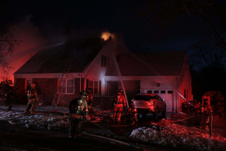 Above and below, firefighters responded to a house fire on Cedar Street in Wallingford Monday evening. Devin Leith-Yessian, Record-Journal