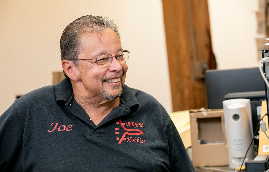 Joe Acosta, owner of Build Right Fly Right Hobbies, smiles while talking about the business at 342 Quinnipiac St. in Wallingford, Tues., Oct. 15, 2019. Acosta is retiring and closing his shop after 25 years. Dave Zajac, Record-Journal