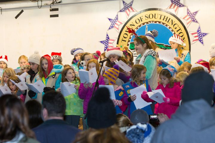 Southington Girl Scouts sing carols on the stage at the Green Friday during White Christmas in the Community in Southington. Dec. 2, 2016 | Justin Weekes / For the Record-Journal