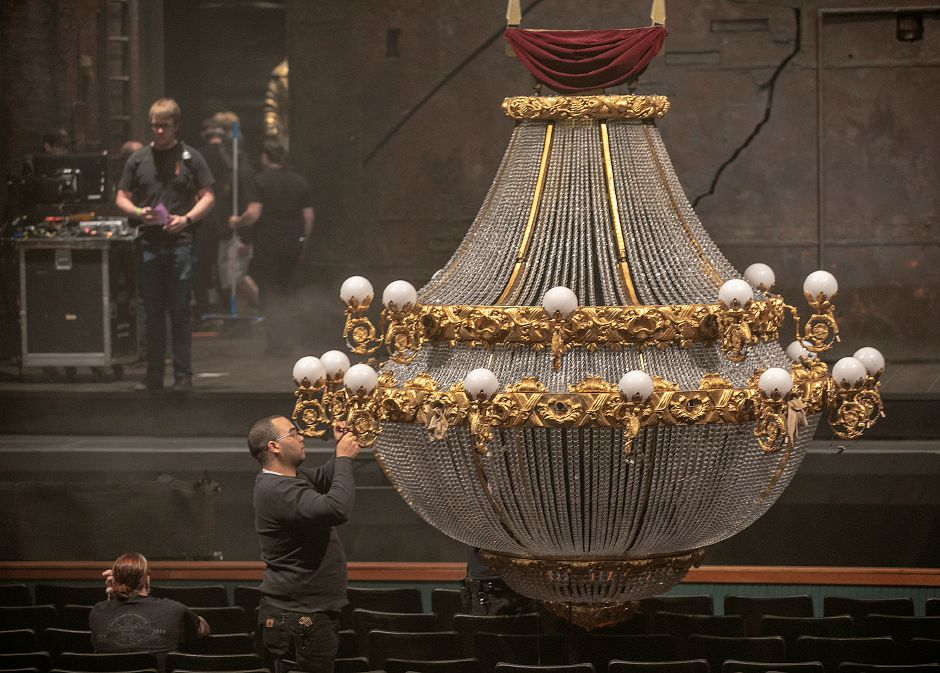 A crew member works on the famous 1-ton chandelier before a performance of The Phantom of the Opera at the Toyota Oakdale Theatre, Thurs., May 9, 2019. Dave Zajac, Record-Journal