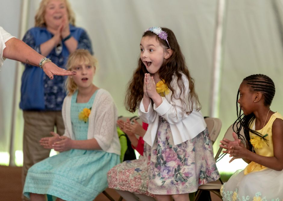 Ben Franklin  School student Scarlett Gibbs reacts to being named Little Miss Daffodil at a crowning ceremony at Hubbard Park on Wednesday. Gibbs will head the Meriden Daffodil Festival Parade on Saturday. The honor escort is  Israel Putnam student Kayden Rodriguez, 8. For more photos, visit us online at www.myrecordjournal.com. Devin Leith-Yessian, Record-Journal