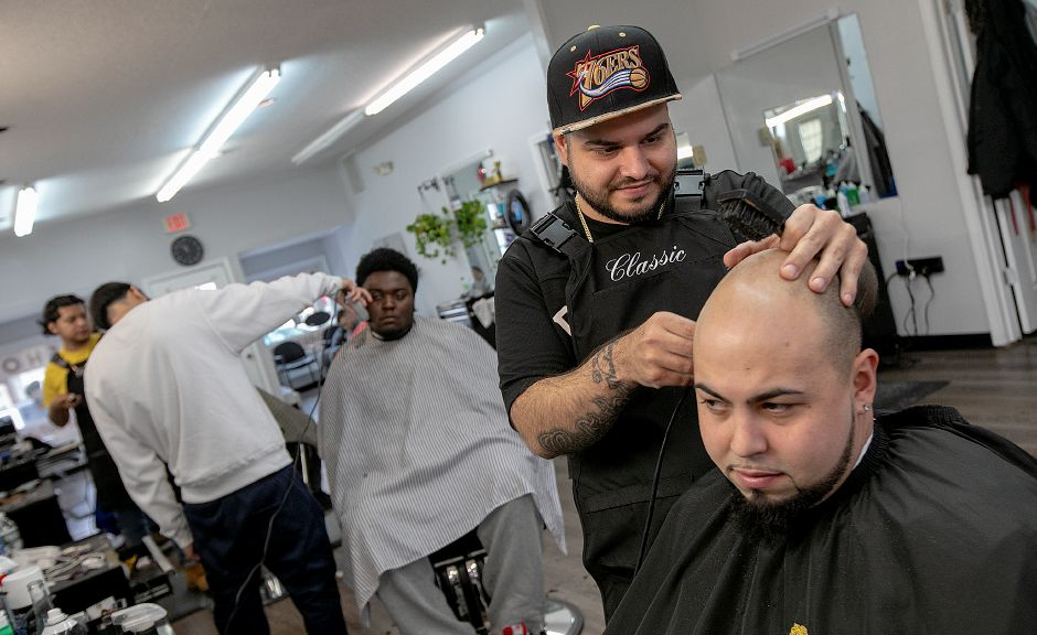 Barber David Ortiz, owner of Classic Cutz, gives a straight razor shave to longtime customer, Larry Velez, of Hamden, at the new shop at 35 N. Colony Rd. in Wallingford, Fri. Feb. 8, 2019. Dave Zajac, Record-Journal