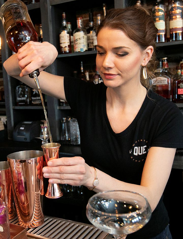 Brooke Kenyon, bar manager, starts a whiskey cocktail at Que Whiskey Kitchen, a barbecue restaurant and whiskey bar located at 461 Queen St, Southington, Wed., Mar. 13, 2019. Dave Zajac, Record-Journal
