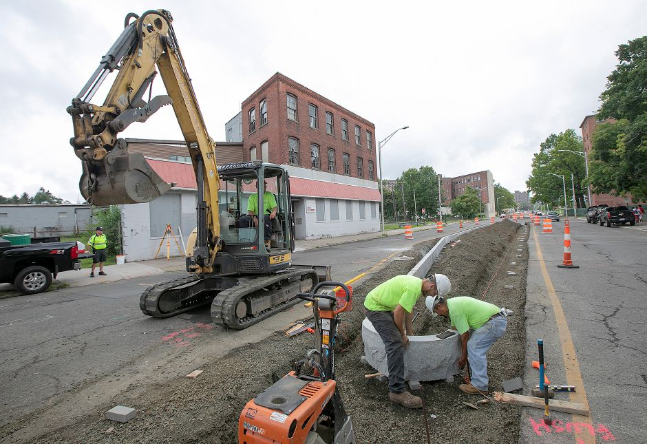 "Crews from LaRosa Construction set  a median section in place on Pratt Street as construction continues Wednesday on a boulevard-style ""gateway"" to downtown Meriden.Dave Zajac, Record-Journal"