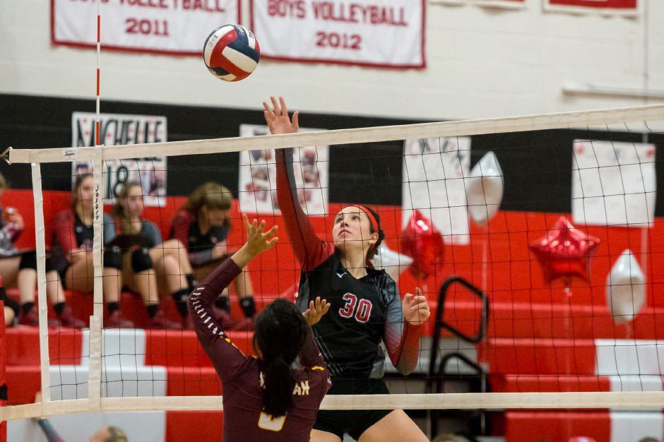 Senior outside hitter Lindsey Abramson racked up seven kills and seven aces in Cheshire's 3-0 season-opening victory Monday night at Sheehan. | Justin Weekes / Special to the Record-Journal
