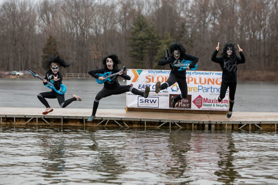 Lake Compounce staff, from left, Ciara Dovaney, Megan Major, Meg Riel and Amanda Antonioli take the plunge Saturday during the 14th annual Sloper Plunge at Camp Sloper in Southington. Photos by Justin Weekes, special to the Record-Journal