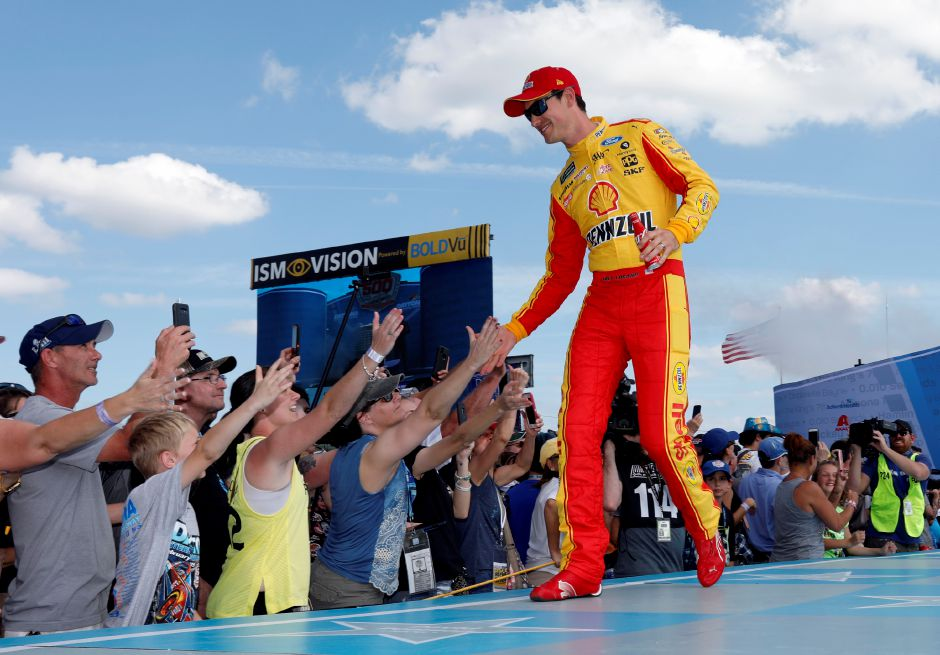 Joey Logano greets fans during driver introductions before the NASCAR Daytona 500 auto race at Daytona International Speedway, Sunday, Feb. 17, 2019, in Daytona Beach, Fla. (AP Photo/Terry Renna)
