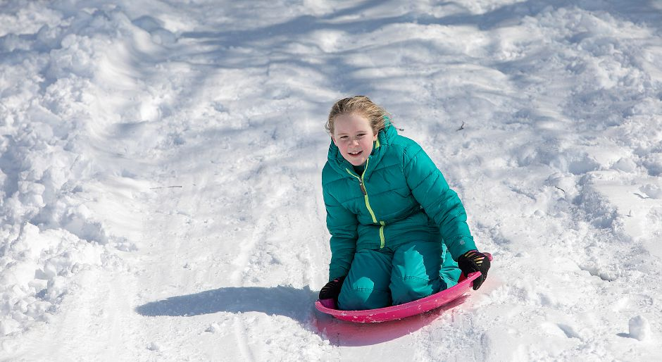 Dakota Aldrich, a 10-year-old Southington resident, takes her turn down the hill.