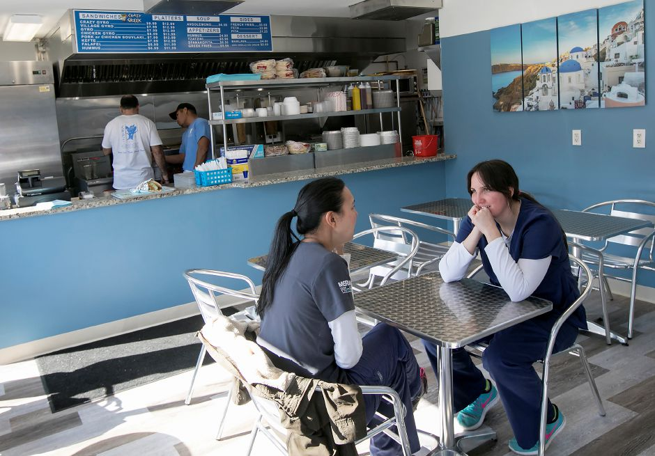 Amy Yamaguchi, of Hamden, left, and friend Valerie Mazrek, of Southington, visit Crazy Greek restaurant at 1143 Meriden-Waterbury Tpke. in Southington, Thursday, February 23, 2017. | Dave Zajac, Record-Journal