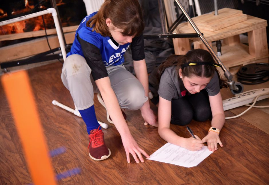 Odyssey of the Mind team members Hope Giammatteo and Allison Booth rework a script during a practice on April 30, 2019 in Middlefield. The team will compete in the Odyssey of the Mind world competition in Michigan later this month. | Bailey Wright, Record-Journal