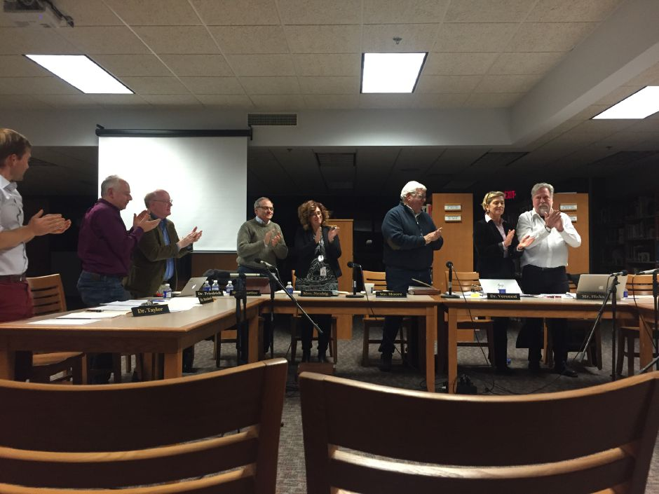 The Regional School District 13 Board of Education claps for member Nancy Boyle, who stepped down at the Nov. 14 regular meeting. Middlefield is still searching for a nominee to take her place. | Bailey Wright, Town Times