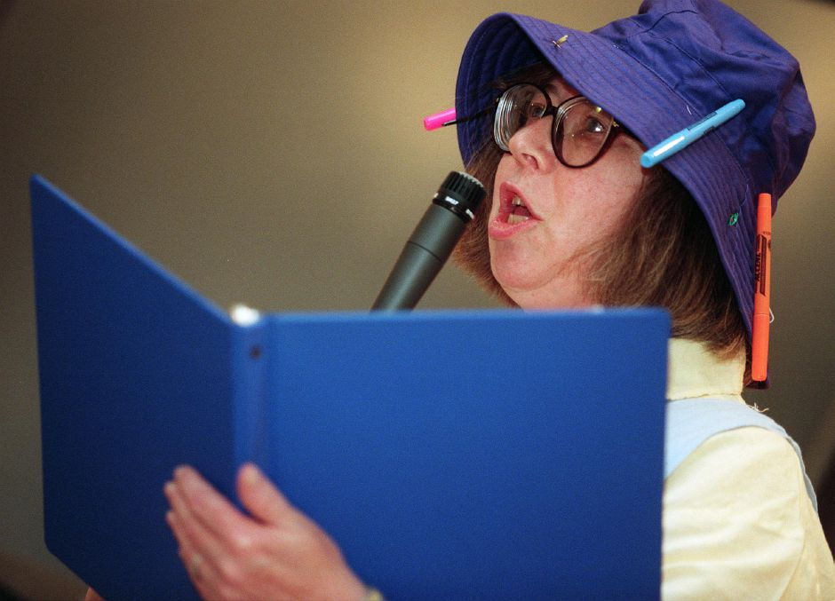 "Carole Slepian, a Recreational Therapist at Masonic Geriatric Health Center in Wallingford, reads a poem she wrote called ""Dinner for Two"" during a presentation by members of the National League of American Pen Women at the Masonic Home July 8, 1999."