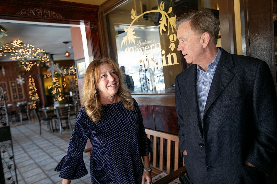 Gov. Ned Lamont visits with Debbie Pacileo, owner of Gaetanos Tavern on Main while on a tour of Wallingford, Thurs., Feb. 28 2019. Dave Zajac, Record-Journal
