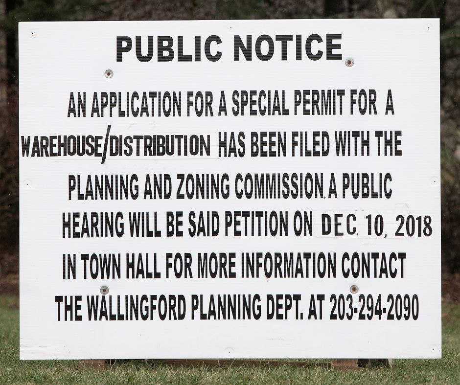 "A ""Public Notice"" sign posted in front of the former Bristol-Myers Squibb property, Fri., Nov. 30, 2018. Dave Zajac, Record-Journal"