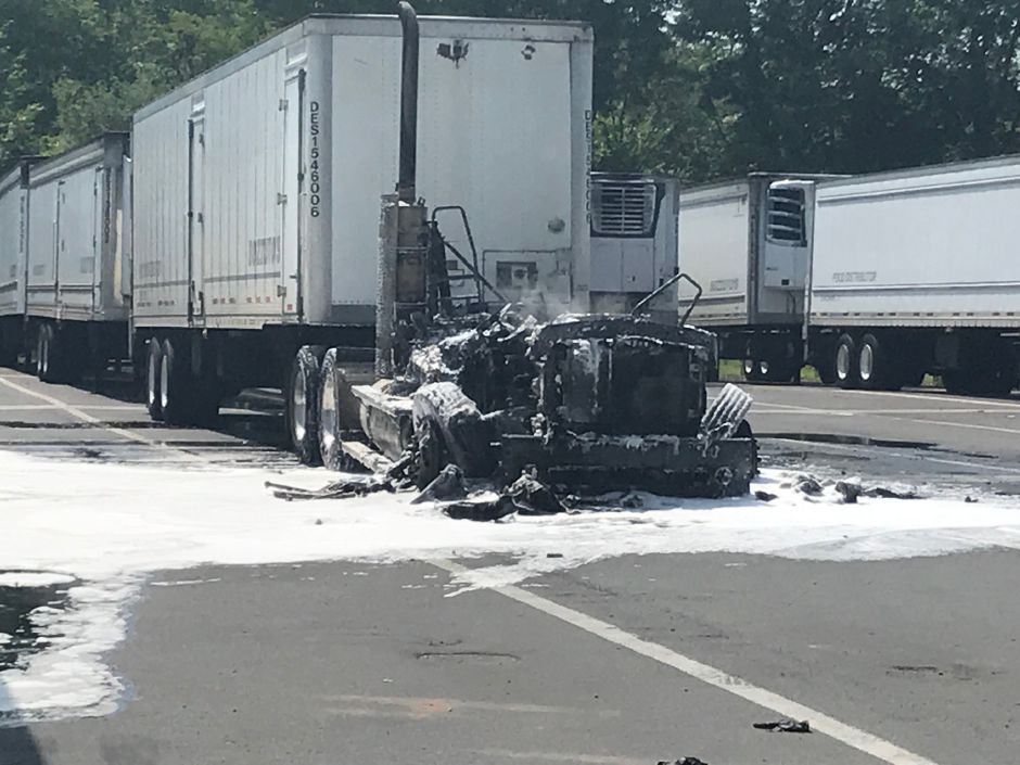 Fire destroyed the cab of a tractor trailer truck at Bozzuto's warehouse, 278 Schoolhouse Road, on Tuesday, July 16, 2019. (Michael Torelli/Cheshire Herald)