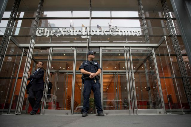 FILE PHOTO: A police officer stands guard outside The New York Times building, Thursday, June 28, 2018, in New York. The New York Police Department has sent patrols to major news media organizations in response to a fatal shooting at a newspaper in Annapolis, Md. (AP Photo/Mary Altaffer)
