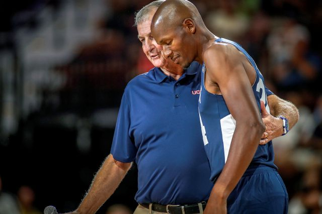Former UConn head basketball coach Jim Calhoun wraps his arm around former UConn and NBA star Ray Allen.