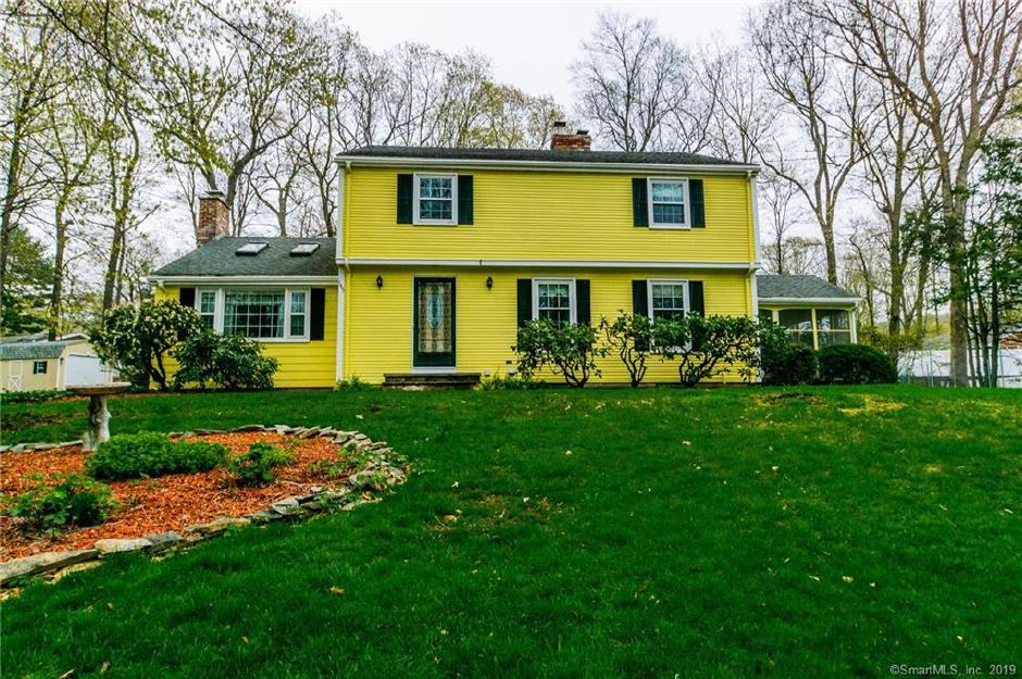 A bright yellow Garrison Colonial with an inground pool is up for sale on the east side of town. Courtesy Carbutti & Co. Realtors